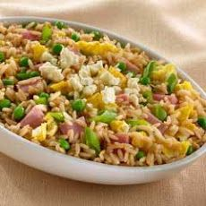 Caribbean Fried Rice Recipe Main Dishes, Side Dishes with vegetable oil, yellow onion, regular or convert rice, garlic, fresh ginger, water, Knorr® Beef Bouillon, cooked ham, green peas, large eggs, chees fresco queso, green onions