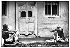 Bin Singh's father (left) with a friend relaxing in front of their home in Jeddah Street in Kampong Glam district southeast of Little India near to Sultan Mosque and Arab Street. Picture taken in January 1983. (text modified from source)