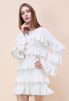 Make a statement at the next soiree without having to say a word. The ruffles on this baby speaks volumes about how untouchable your style truly is.