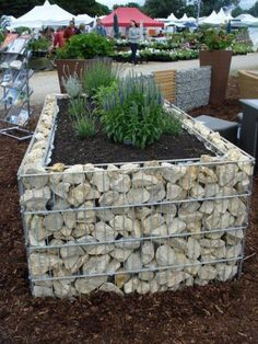 Another material idea--gabion walls. These can be filled with literally anything--old broken pots, glass bottles, wood...