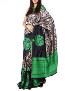 Black and Green Benarasi Silk Saree from Sayisha. A beautiful number with intricate detailing on the Benarasi upadda design. Ideal for occasion wear or a cocktail evening! Blouse Piece is available with the saree & the blouse in the image is used only for photography. There could be a slight variation in color due to digital photography.