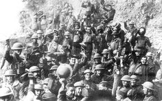 Men of US 64th Regiment 7th Infantry Division celebrate the news of the Armistice 11 November 1918.