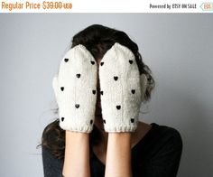 Those lovely wool mittens is hand knitted, studded and designed by us. Isn`t those the cutest mittens for cold winter days or as a meaningful gift? :)