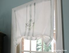 Hand-made window treatments using plain white linen, Annie Sloan Chalk Paint, painter's tape and transfer paper.
