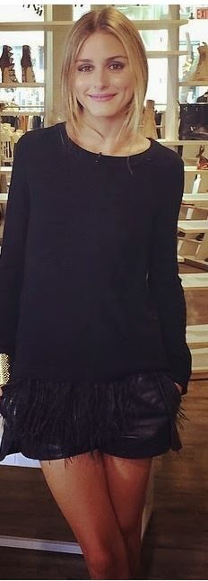 Olivia Palermo looking chic in a black feather sweater