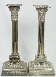 """Pr FINE ANTIQUE ENGLISH SILVERPLATE CANDLESTICKS Pair of finely crafted English silver plated weighted candlesticks. Each has an exquisite Corinthian Greek column design. Has a raised scroll throughout base with beaded borders. Includes original beaded cover inserts. 18th/19th century. Each measures approx. 11 1/4"""" height x 4 3/8"""" width x 4 3/8"""" depth (28.5cm x 11.1cm x 11.1cm). Total weight of 2068 grams."""