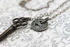 "Buffalo Necklace - ""Good for One City Fare"" repurposed vintage silver Buffalo NY transit token, skeleton key, lariat or wrap style necklace. $37.16, via Etsy."