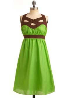 Love the brown accent on this bright green dress!