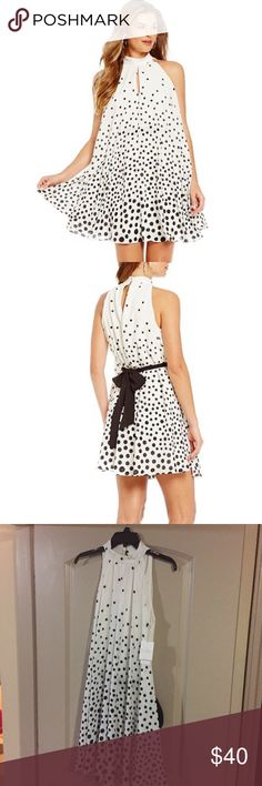 "Jessica Simpson Polka Dot Trapeze Dress From Jessica Simpson, this dress features: polka dot-print halter neckline sleeveless button/keyhole at back neck approx. length 31"" polyester dry clean Jessica Simpson Dresses"