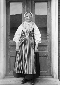 1935 photograph of a farmers wife, Greta Persson, in traditional folk dress from Almo, Dalarna, Sweden.