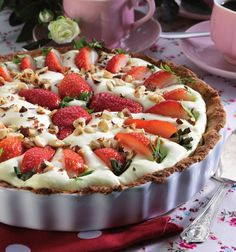 With a light, creamy filling, a #sweet #strawberry and #hazelnut topping and a crispy crust, this #tart is a fantastic fusion of tastes and textures!