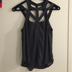 Nordstrom Grey Tank with Cutouts The most flattering shirt ever! Cutouts in the straps make this shirt interesting and flirty for nights out. Nordstrom Tops Tank Tops