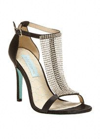 """Step out in style with these Blue by Betsey Johnson crystal mesh T-strap sandals.  Center meshT-strap is adornded with dazzling crystals.  Heel height: 4"""".  Imported."""
