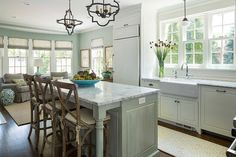 Kitchen Island is Benjamin Moore Tranquility with a gray glaze over it, Perimeter cabinets are BM White Dove
