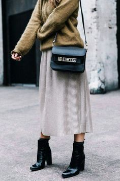 {Sweater, midi skirt and ankle boots.}