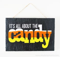 """Halloween """"It's All About the Candy"""" Sign at artsyfartsymama.com #MakeItFunCrafts"""