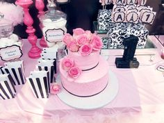 favor bags for candy buffet: powdered doughnuts. Black sparkly 60 numbers for tables. Boxes wrapped in black and white wrapping paper to and depth and height, pink candle stick holders