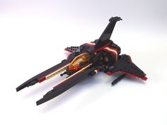 https://flic.kr/p/aBBs8Y | SD-10 Valarauko | This powerful starfighter belongs to one Tolwyn Nar, a vicious mercenary who rarely leaves survivors. If you can afford his price, you can be sure of your target's complete destruction. Some say his ship was a stolen Illyrian prototype, but others claim it is far older. While working with Zax (aka Rich M) on some designs for his game, I modified this design to my liking. For this version I stretched the forward prongs a bit, moved the vertical...