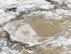 Snow-covered deserts are rare, but that's exactly what the Moderate Resolution Imaging Spectroradiometer (MODIS) on NASA's Aqua satellite observed as it passed over the Taklimakan Desert in western China on Jan. Nasa Photos, Nasa Images, In China, Desert Snow, Global Thinking, Nasa Missions, The Weather Channel, Image Of The Day, Earth From Space