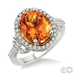 11x9mm Oval Cut Citrine and 3/8 Ctw Round Cut Diamond Ring in 14K White Gold