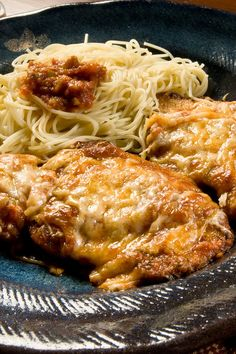 The Best Parmesan Chicken Bake Recipe with Garlic, Marinara Sauce, Basil, Mozzarella Cheese, Parmesan Cheese, and Croutons