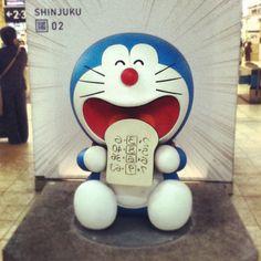"loosersugar:  #doraemon #japan #shinjuku station (at 新宿駅 (Shinjuku Sta.))  Doraemon is eating 「テストにアンキパン」or ""memorizing toast"". Wouldn't it be great never having to study for a test again?"