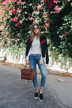 Long sleeve t-shirt, cuffed jeans, bomber jacket and slip on sneakers.