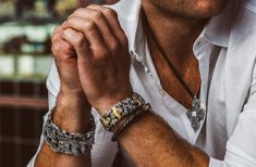 William Henry strings a hand-fused, hand-colored Japanese Mokume Gane metal bead on tough braided black leather on this exotic men's leather bracelet. Male Fashion Trends, Mens Fashion, Mr Roboto, Black Gold Jewelry, Omega Seamaster, Pandora Jewelry, Men's Jewelry, Jewellery, Yoga Jewelry