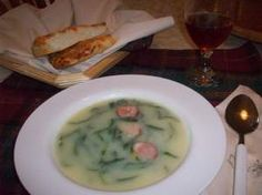 Caldo Verde. Probably my favorite soup in the whole world. Memories of pots of this soup simmering in my grandma's tiny house, filling the neighborhood with the yummiest, most comforting smells. Fresh Portuguese bread, queijinho fresco and an agua das Pedras Salgadas.     I want to go home to Portugal!!!!