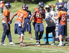 """Thursday Practice, Wide Recievers Group, The Broncos all time recieving leader, Rod Smith, came in for the week to give the """"kids"""" some tips on rout running. He was one of the best."""