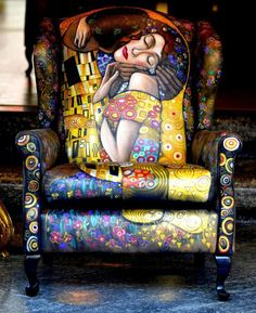 leather hand painted chair with the art of Gustav Klimt. If I ever find a leather chair in this style for a good price I am definitely going to give this my best shot.