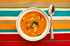 Spicy, creamy Thai Coconut Soup from Love Handling Food is loaded with veggies and spices.