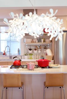 light. wow. also love the pink in this kitchen...very cool.