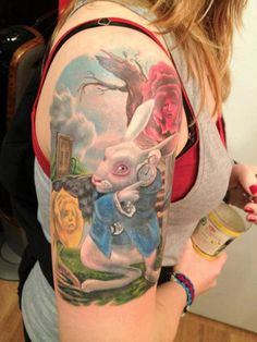 Alice in wonderland rabbit tattoo