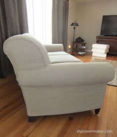 Linen slipcover custom made with the Home Furnishing quality from Gray Line Linen. This fabric is great for slipcovers...heavyweight, floppy and softly crumpled after wash. Love it! slipcovermaker.com