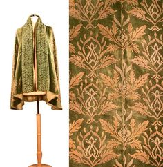 Green Silk Velvet Stenciled Cape   Attributed to Gallenga, 1920s   Ruched collar, silver and gold Italianate thistle motif, sage green silk lining, no label.