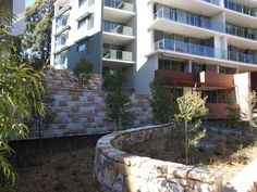 Rockface Sandstone Wall and Stone Garden Edging Australian Sandstone Rockface Wall Cladding + Sandst Sandstone Wall, Stone Supplier, Garden Edging, Wall Cladding, Garden Stones, Landscape Architecture, Natural Stones, Patio, Mansions