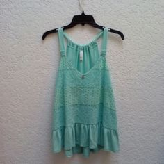 Xhilaration Teal Flowy Eyelet Tank Xhilaration brand from Target, size medium, in excellent condition! This teal tank is flowy and perfect for summer! Features a lace/crochet/eyelet design in the fabric, v-neck with two buttons, and a tiered look to the body. No trades. Make a reasonable offer. Please ask any and all questions before purchasing. Thanks! Xhilaration Tops Tank Tops