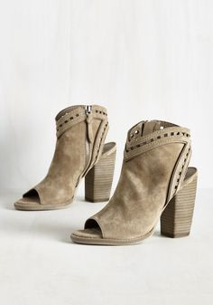 The elevator isn't the only thing that's going up - these taupe suede booties by Dolce Vita are also rising the ranks as your faves to sport! Made posh by a peep toe, heel cutout, and ladder trim, this stacked-heel pair makes stepping into the penthouse party an outburst of brilliantly chic style.