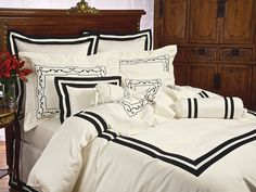 Fellini - Fine Bed Linens - As unexpected as coming upon an unknown piazza in Rome, a striking architectural motif is embroidered in Black Onyx on glistening Ivory cotton sateen, 300 thread count