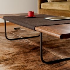Local Seattle company Ample 'Sfelt' coffee table with giant, built-in washable, wool 'coaster'.  Beautiful plus practical always wins in my book.