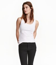 White. Fitted vest top in soft stretch jersey.