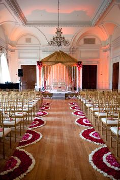 """Your walk down the aisle has never looked better … literally! One of our favorite wedding decorations for ceremonies is sometimes called """"petal carpets""""."""