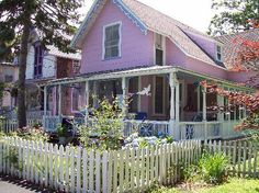 Lavender House with White Picket Fence, I love lavender but I don't think I would paint my house that color.