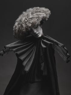 """In her latest collection, Lauren Moser takes naturally curly hair and gives it an Elizabethan edge. Highlighting growing trends in the industry, not as just """"natural"""" but now creating new shapes within their medium. Lauren gives us insight into how she got the final shots, where her inspiration came from, and her biggest challenges in creating this collection. Keep reading to learn more about her beautiful art!"""