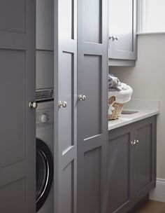If you have the space, a utility room is a great place to store additional kitchen items, but the primary function is to tidy away laundry appliances and cleaning equipment. In this modern grey Original Shaker utility room by John Lewis of Hungerford, the Boot Room, Shaker Kitchen, Toilet Room, Small Utility Room, Boot Room Utility, Hidden Laundry, Kitchen Utilities, Utility Cupboard, Laundry Appliances