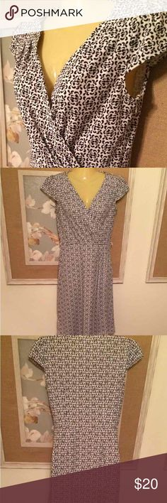 """Ann Taylor Loft Faux Wrap Dress Black and white excellent condition. No belt. Side zip. Cute pleats/tucks at shoulder, bust, waist. Dress is faux wrap so you don't have to worry about the skirt flying open. 13"""" across waist, 37"""" total length. It's made of that miracle knit - stretchy but opaque and impossible to wrinkle. I'd say it's a big 0 and the style accommodates a variety of shapes/proportions. Please ask if you need more measurements. Ann Taylor Dresses Midi"""