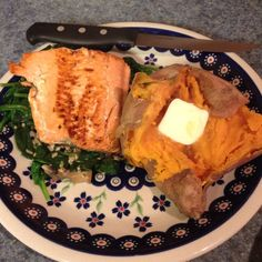 Grilled salmon on sautéed spinach, mushrooms, and garlic with a baked sweet potato - from Eating for Life by Bill Phillips