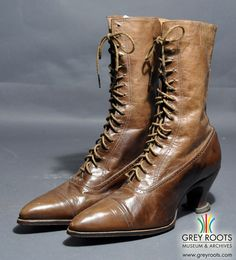 A pair of brown leather, high-topped, ladies' boots c. 1915. They feature very pointed toes and a Queen heel of about 2 inches. The boots are lined with a heavy, white cotton fabric. Grey Roots Museum & Archives Collection.