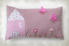 The most relaxing piece of the bed or the couch is this purple decorative pillow by LullabyGigi.   The small world depicted on the pillow, with the little house, the flowers and the butterflies will make you feel that you're travelling back to your most innocent and carefree memories!